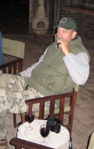 Wine and cigar after evening hunt